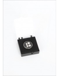 Black button badge with needle fastener in a gift box